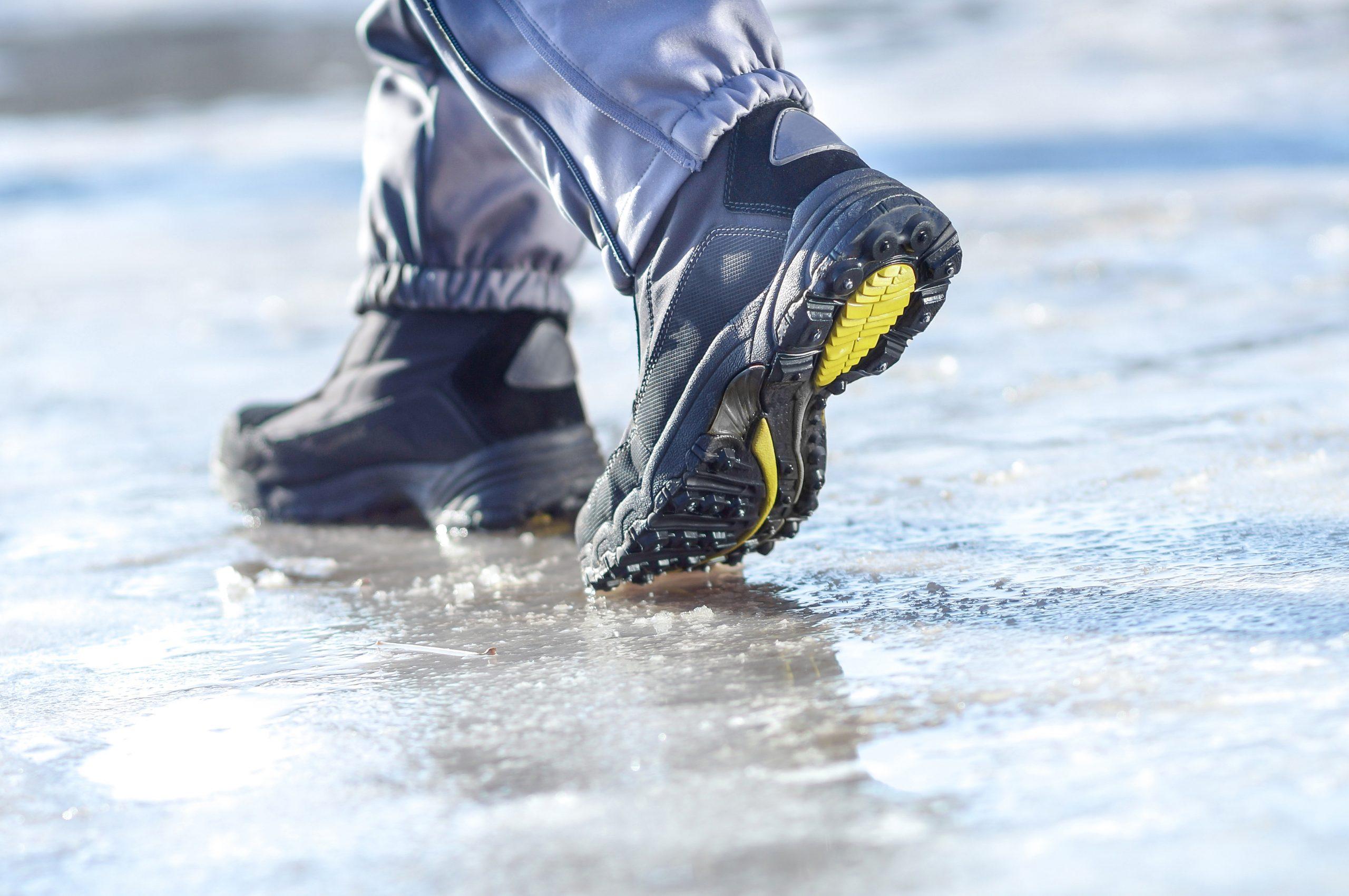 winter boots walking on snowy sleet road